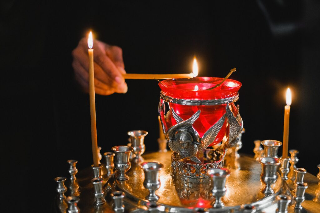 Red and Gold Candles on Brass Candle Holder